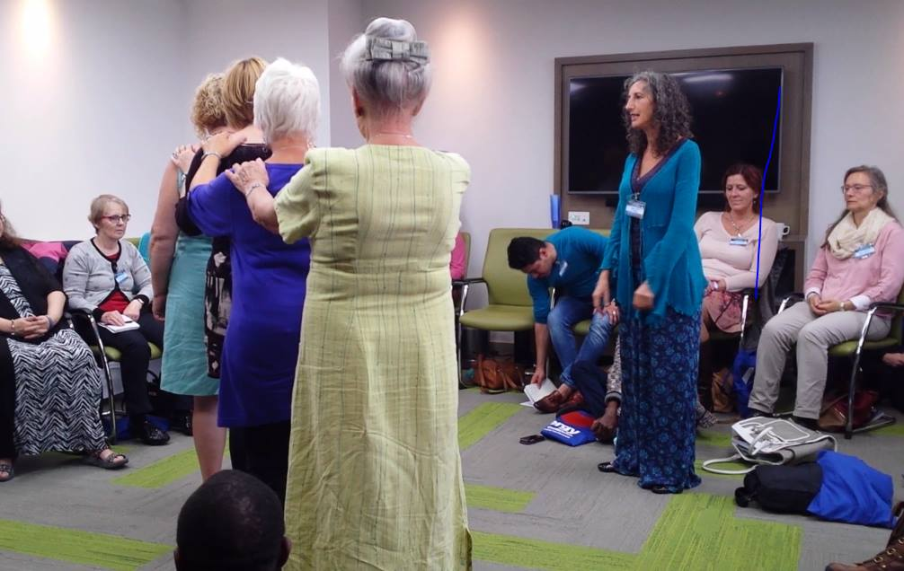Women representing a line of mothers in a family constellation presentation at the AMT conference